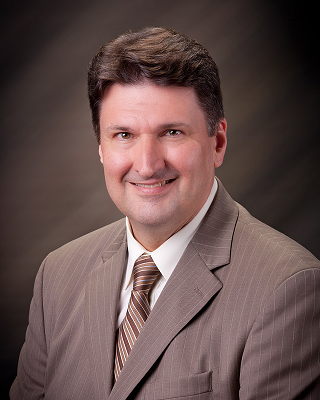 Joe Yelich, superintendent, posed shot wearing suit and tie
