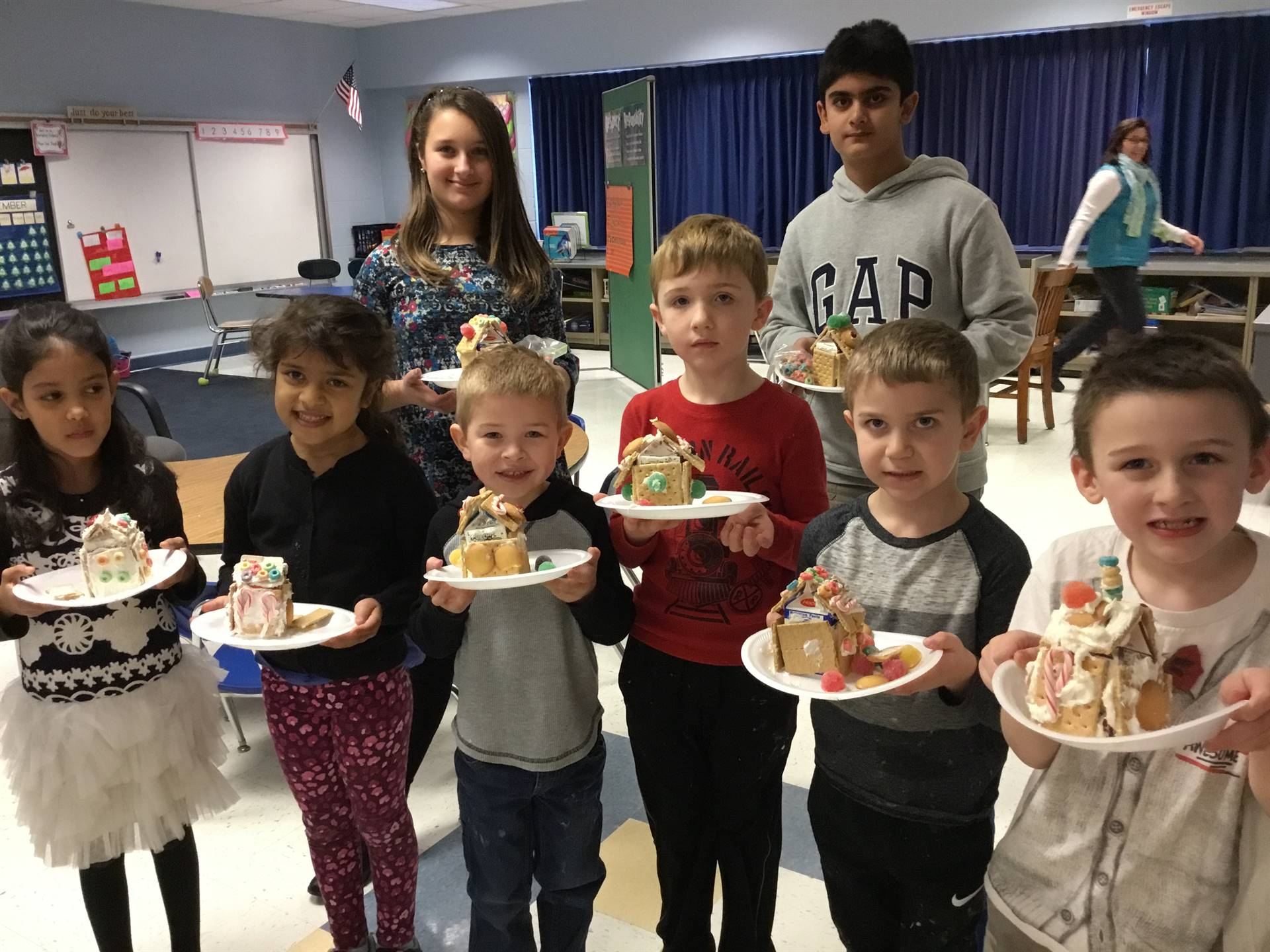 First grade and 5th grade made gingerbread together