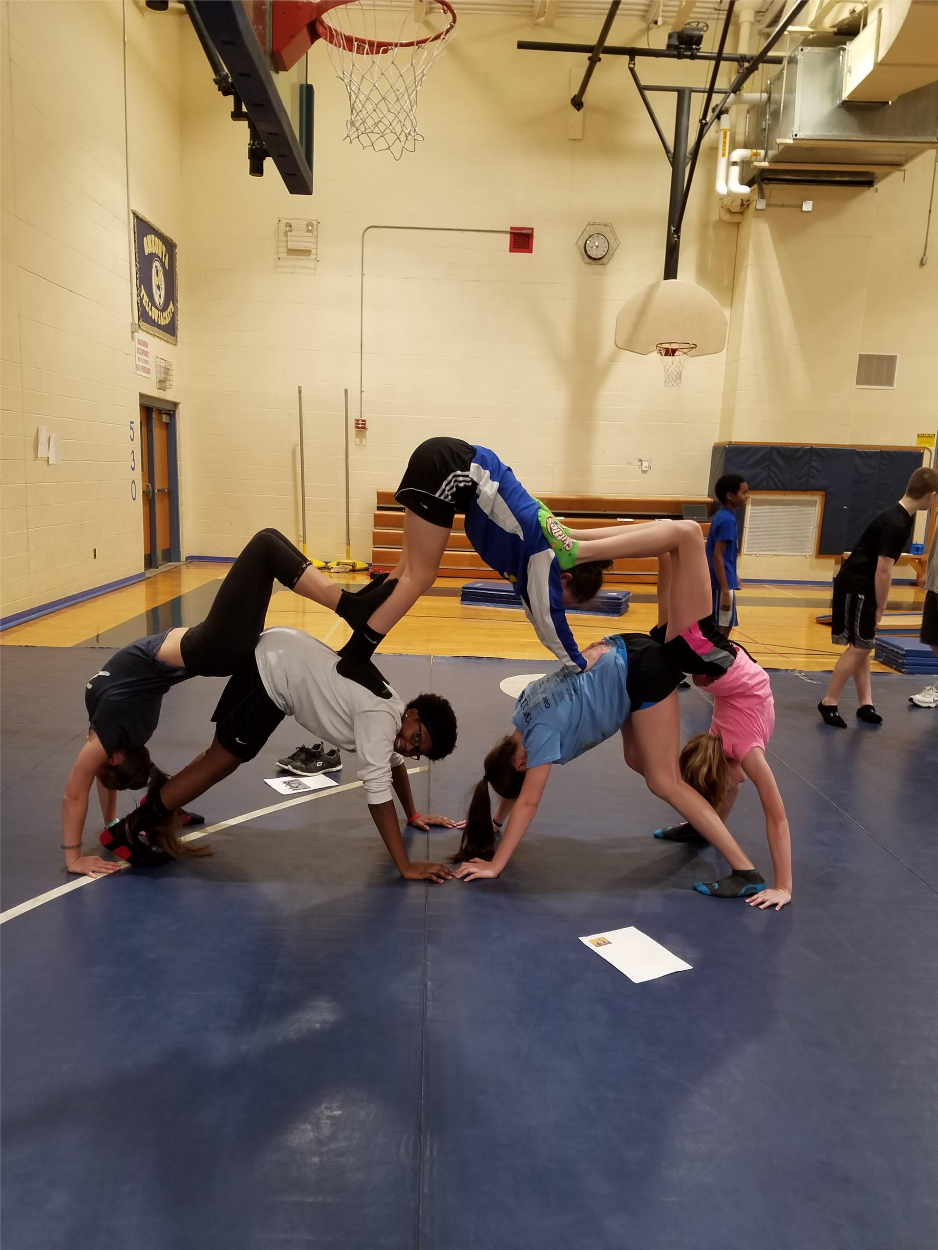 Students doing gymnastics during PE class