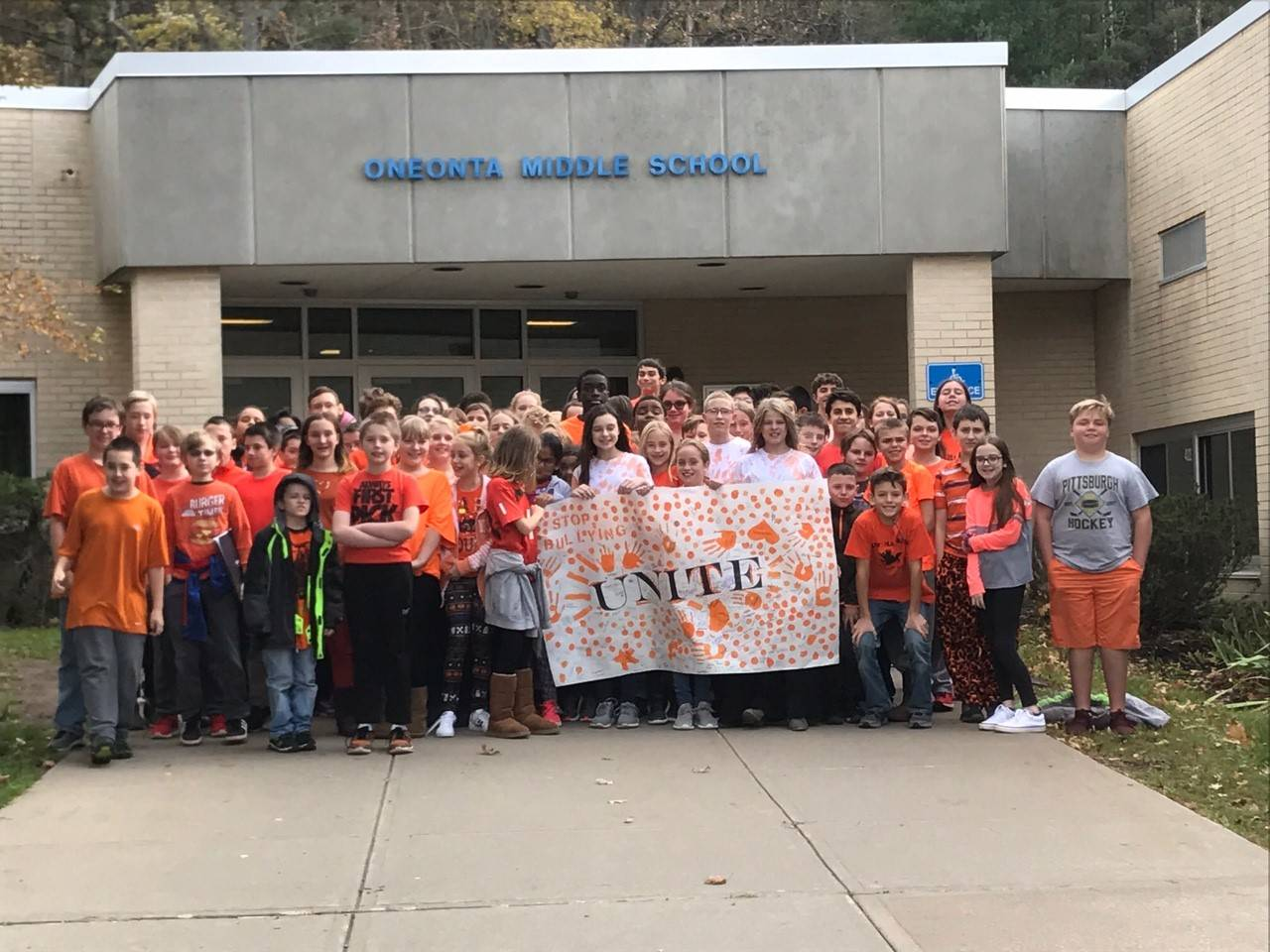 Students gathered outside the OMS school.