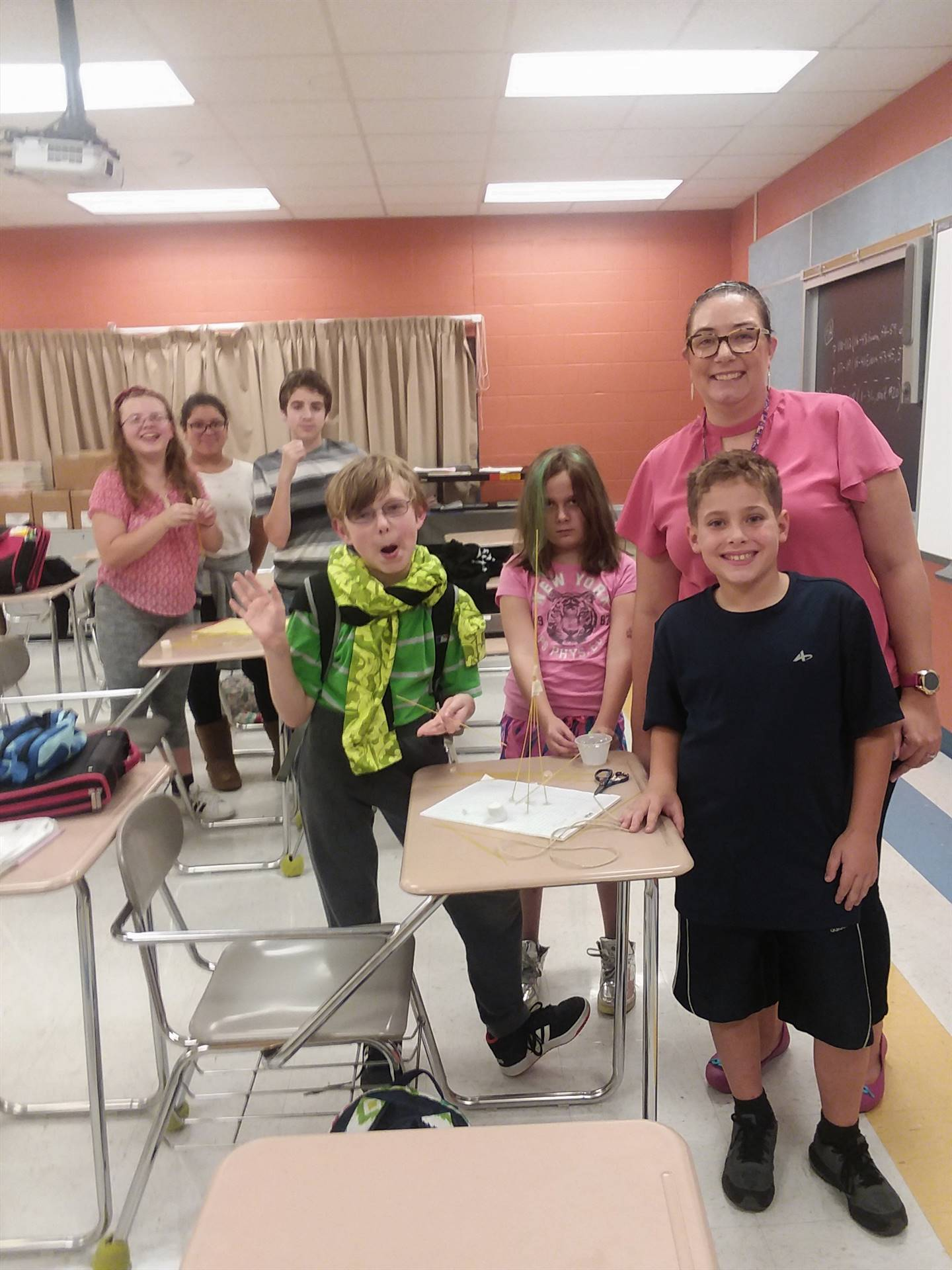 Students and teacher standing in classroom