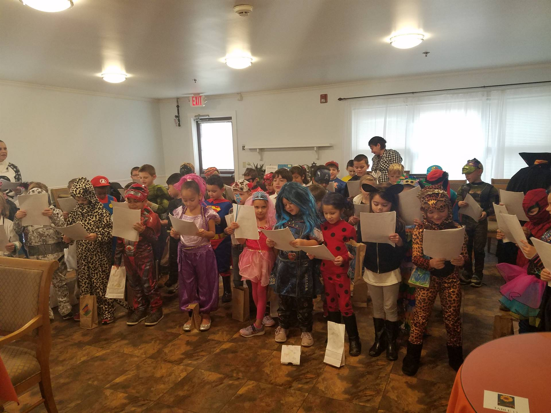 First grade students visit local nursing homes