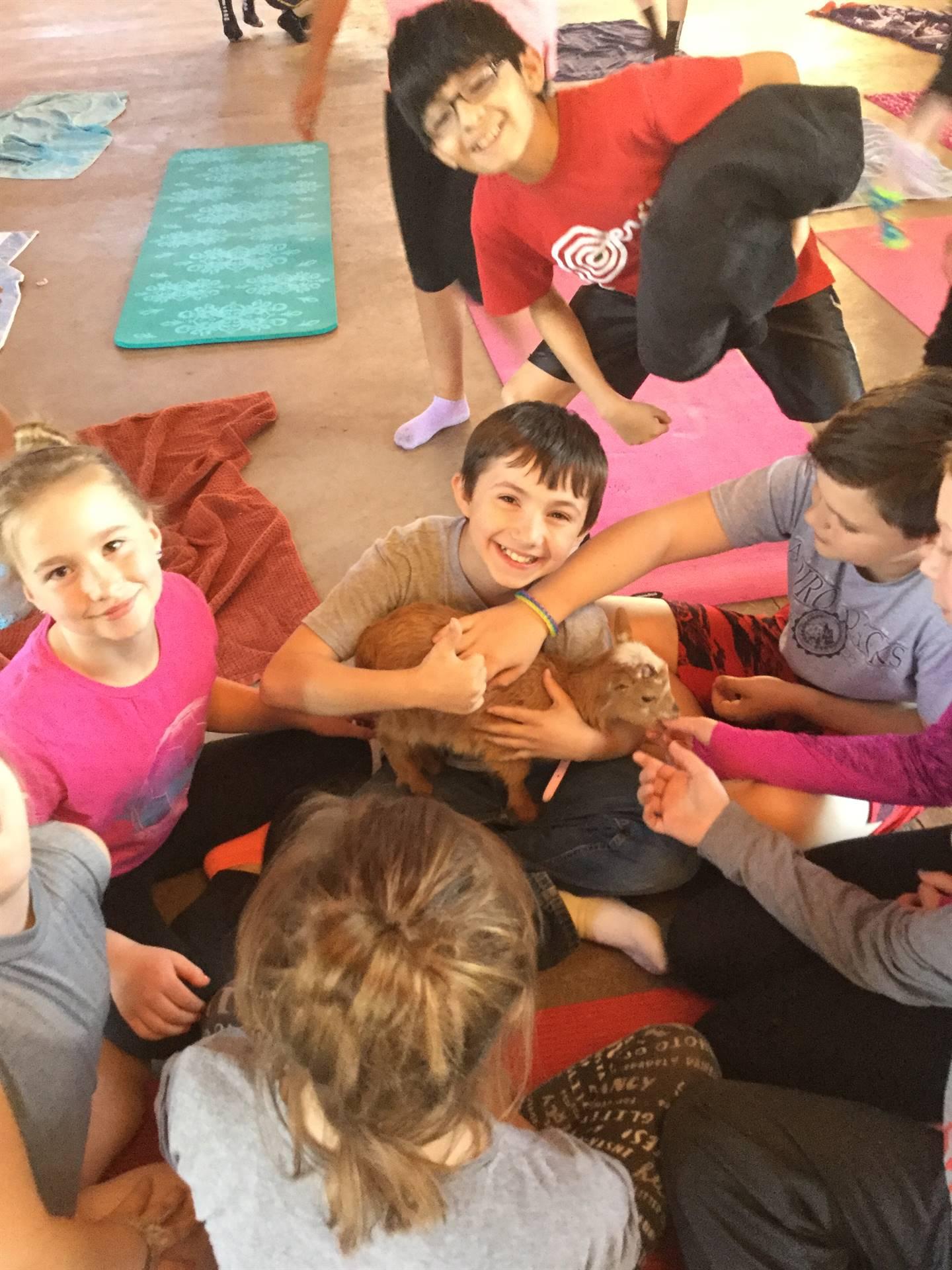 Students pet goat