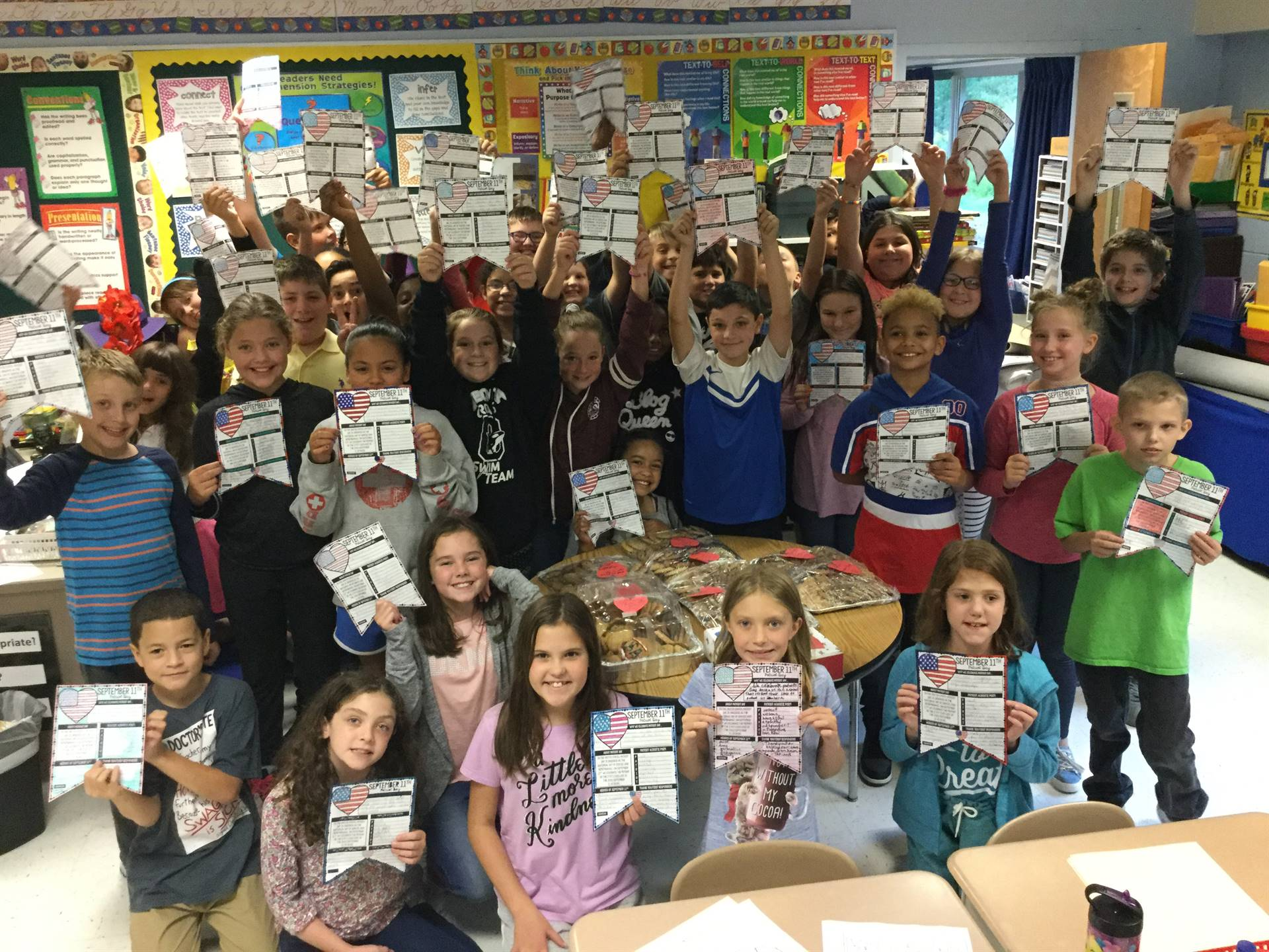 Fifth graders made cookies for local firefighters, police, and state troopers in honor of Patriot Da