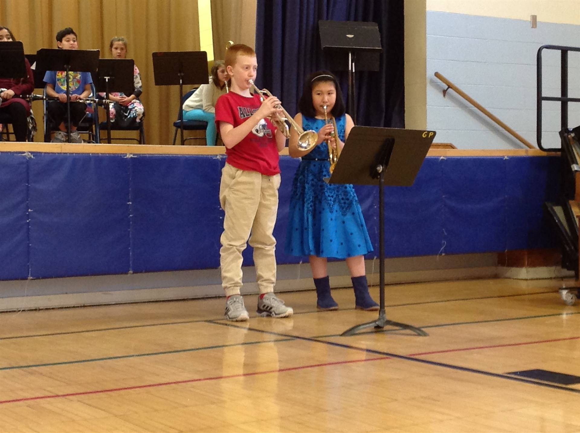 students playing the trumpet at concert