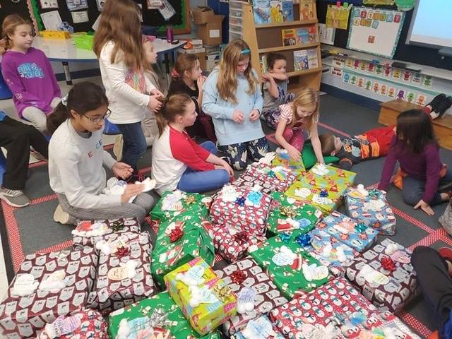 Students wrapping shoeboxes