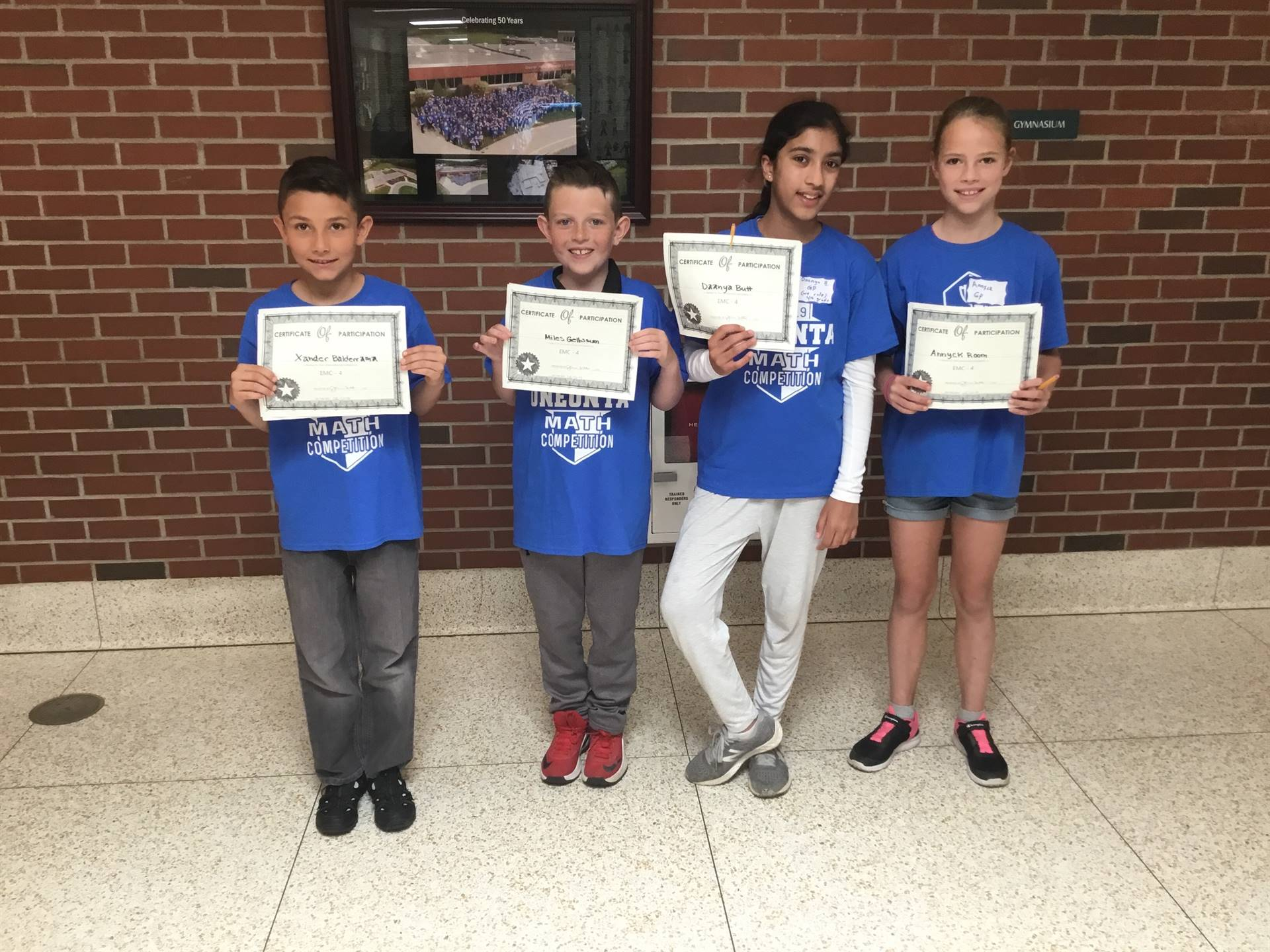Fourth Grade Math Bowl Participants hold up their certificates