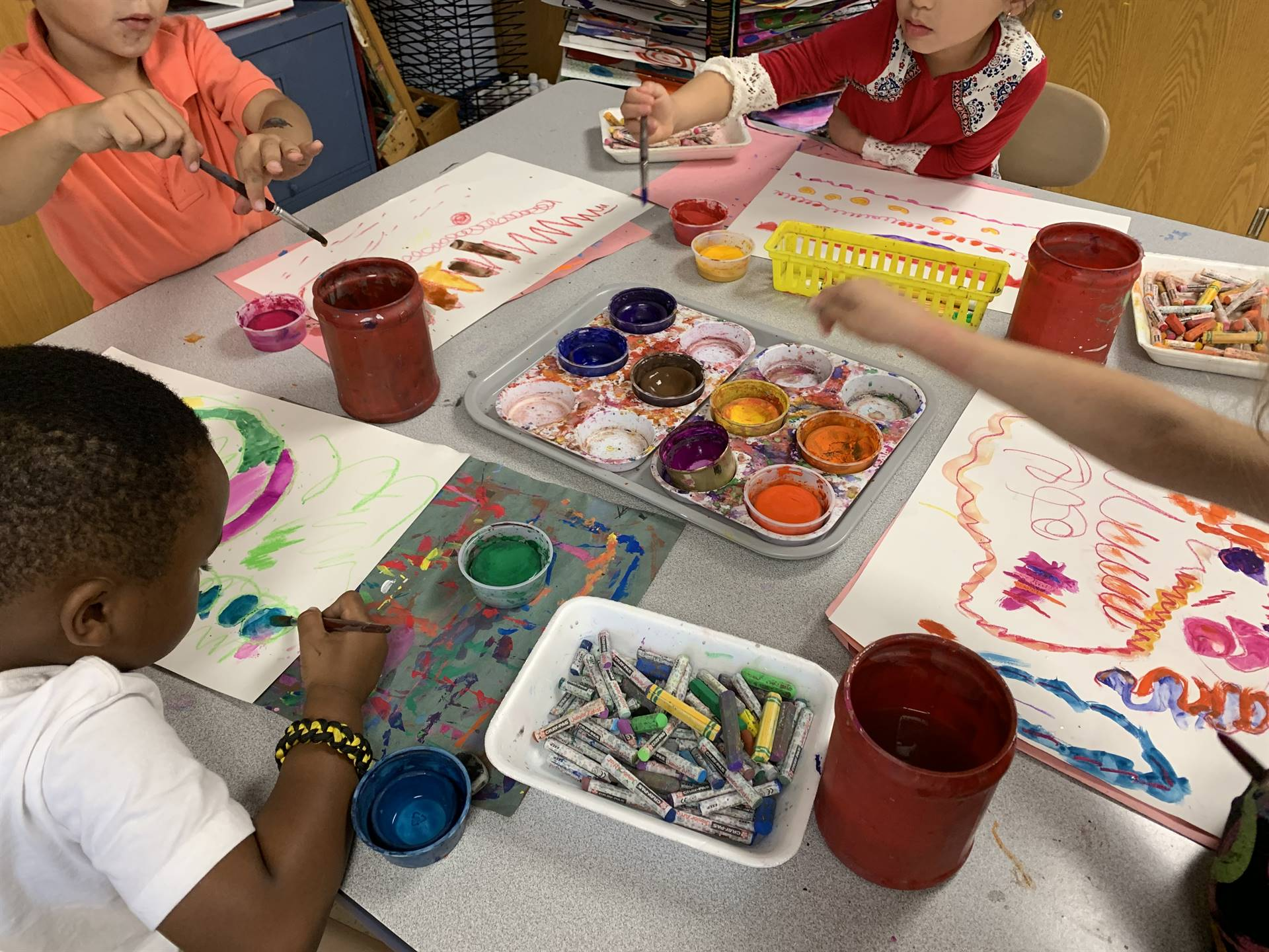 Kindergarteners painting