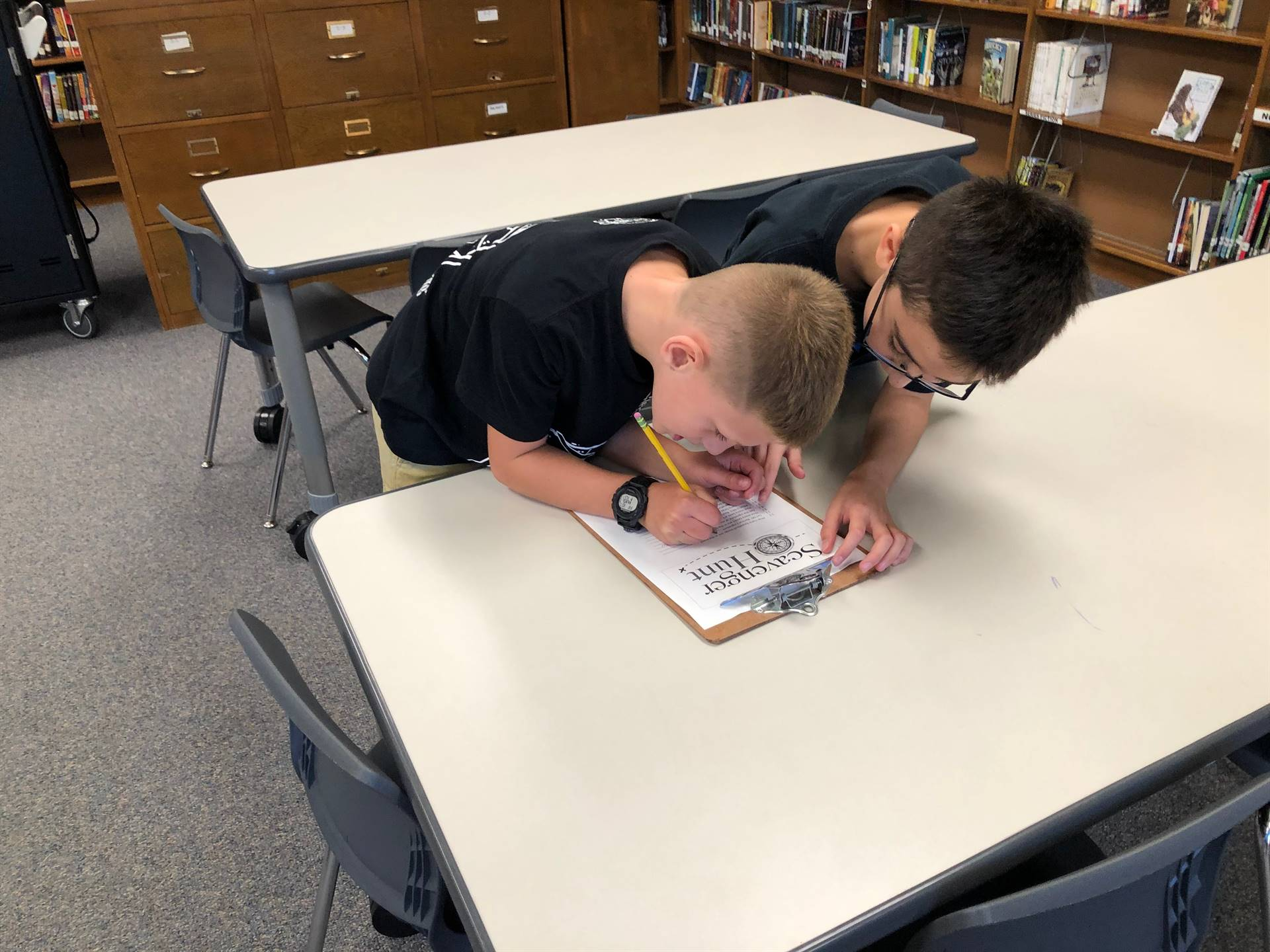 Students working on scavenger hunt clues