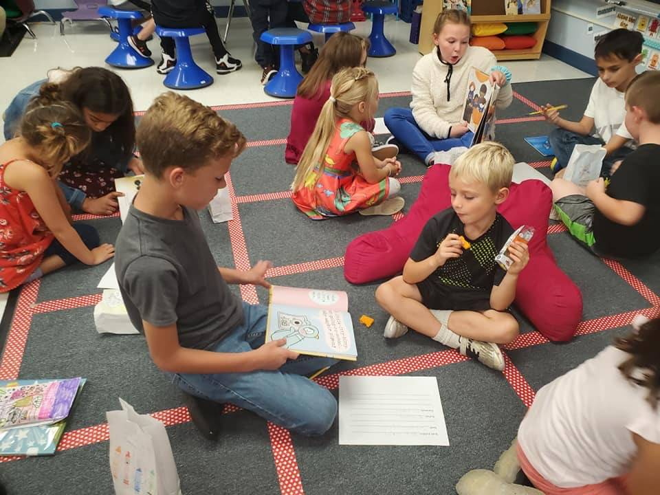 5th Graders and 1st Graders reading together