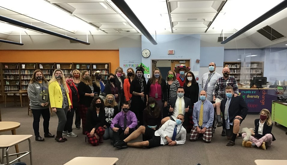 "OMS staff dressed for Halloween as ""Virtual Teachers"""