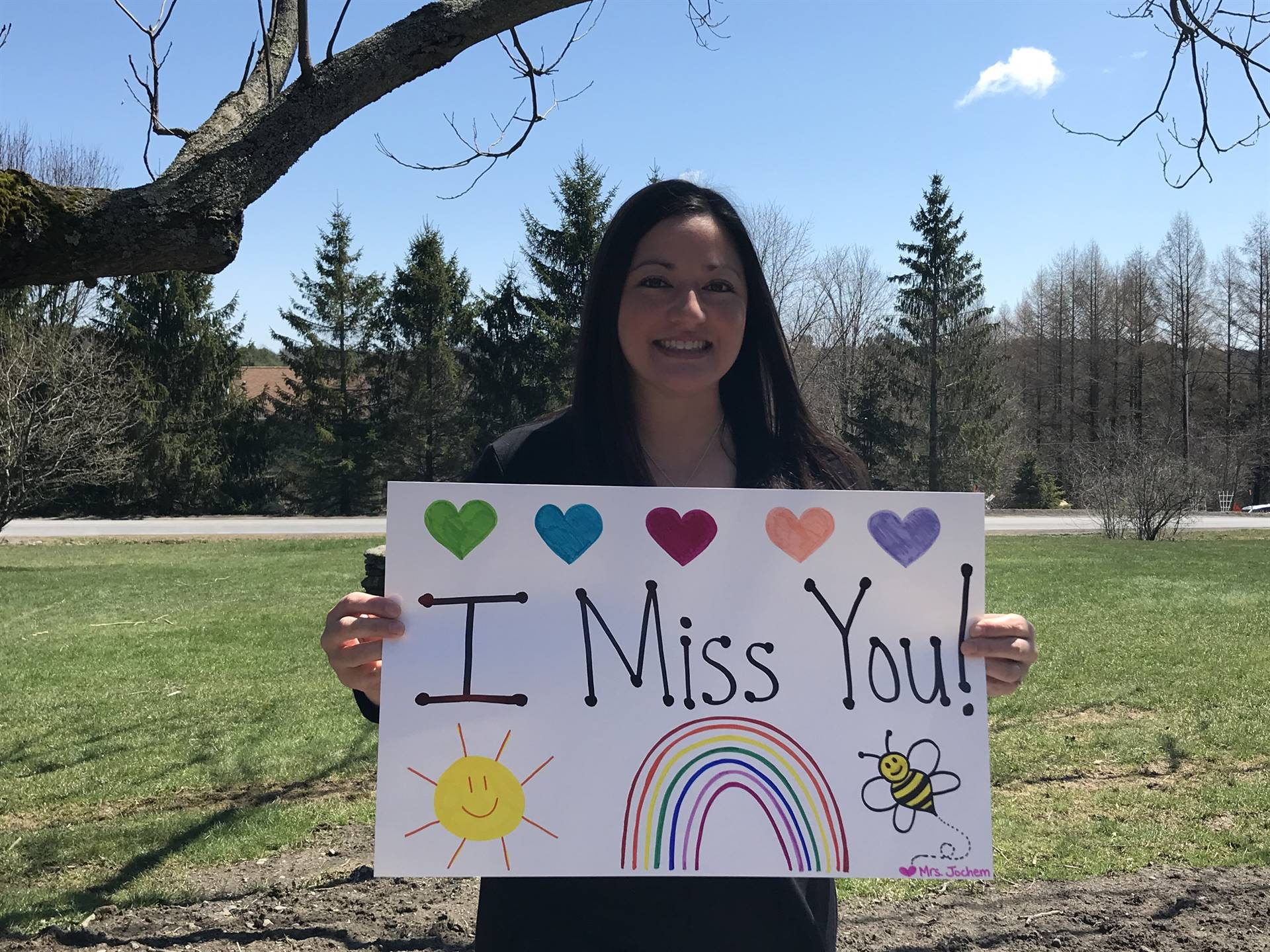 "Teachers say ""we miss you"" to students"