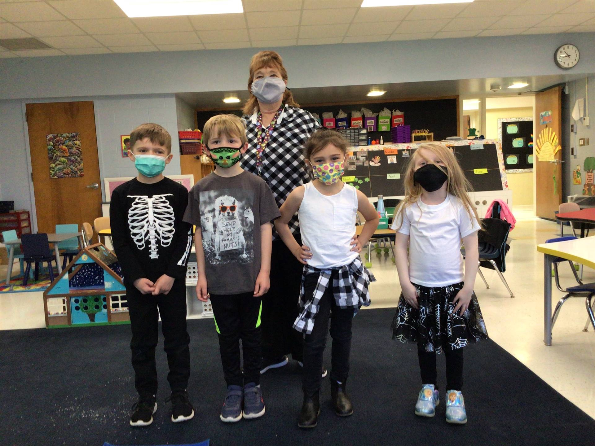 students dressed in black and white