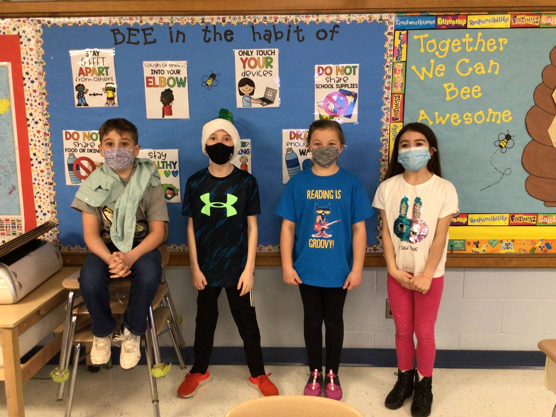 students with hats and masks