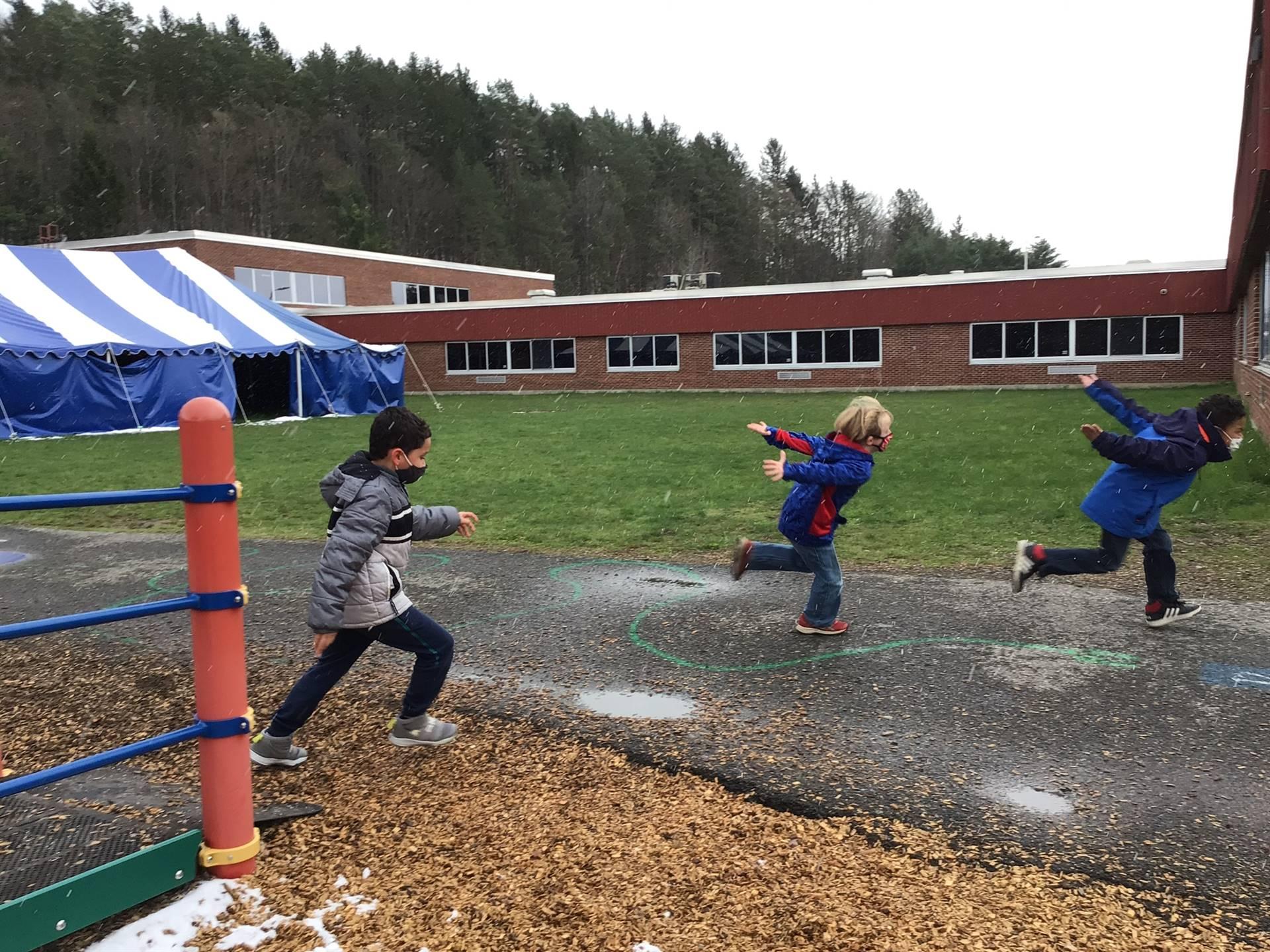 students running on playground
